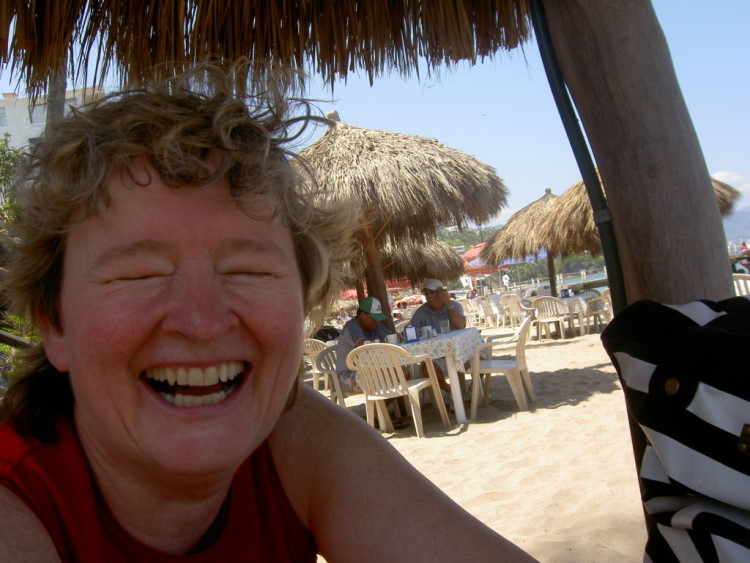 Monika Krammer laughing with beach cabana background
